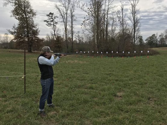 son-in-law firing old 1963 Colt Auto at a Turkey Shoot