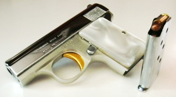 1968 Browning .25 caliber pistol with magazine removed